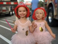 Haley Reece, 3, and Chloe Rozar, 3, checked out the fire truck after their dance class.
