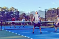 """Collins and Synder Pearson, far court, defend a shot from David Nolen and James Saunders in the Men's Intermediate Championship on Sunday. The Pearson brothers, who are the current Men's Intermediate Wilson County Champions also won gold Sunday in """"Hearts & Dinks"""" Pickleball Tournament at Rotary Park."""