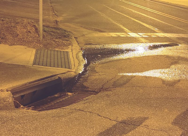 A leak is shown Oct. 2 on Branch Street in downtown Spring Hope. The continued leak could lead to serious problems like sinkhole erosion, according to Tony Jefferys, a retired construction contractor and candidate for town commissioner.