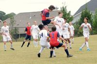 Franklin Academy's Nick Fitzgerald rises up to head the ball on a corner kick.