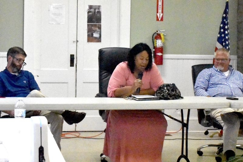 Spring Hope Commissioners Drew Griffin, left, Prudence Wilkins and Brent Cone discuss a rezoning mistake the board made earlier this year during Thursday's candidate forum.