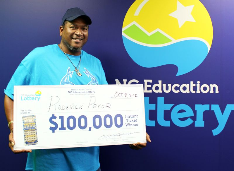 Roderick Pryor celebrates his $100,000 lottery prize with an oversize replica check. Pryor won the money from the N.C. Education Lottery's $25 Spectacular Riches scratch-off game.