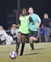 Aisha Ramsey of PSG dribbles the ball as Real Madrid's Jeremiah Warren gives chase during a Wilson Parks and Recreation Department youth soccer coed ages 13-15 match Sept. 30 at Gillette Soccer Complex.