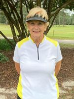 Shirley Baker accomplished a noted golfing feat by shooting her age to win the Willow Springs Country Club Ladies golf championship recently.