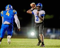 Hunt quarterback Mike Thomas passes the ball during Friday's game at East Wake, which the Warriors won 35-0. Hunt will host South Johnston on Friday in a game that could decide the 3-A Quad County Conference title.