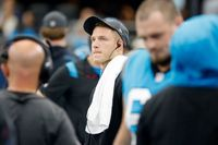 Carolina Panthers running back Christian McCaffrey watches play from the sideline against the Dallas Cowboys in the first half of a game in Arlington, Texas, on Oct. 3.