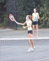 Fike's Caroline Adkins hits a shot as twin sister and doubles teammate Kathryn Adkins during their 3-A Quad County Conference semifinals match against Hunt's Emerson Mills-Hannah Mosley on Wednesday at Barton College Tennis Complex. The Adkins twins won the conference championship as they improved to 18-0 on the season in doubles.