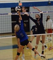 Hunt's Alexis Winbourne (2) tries to tap the ball past Fike's Mallory Jenkins during Thursday's match at Hunt. Winbourne was one of five Lady Warriors honored on Senior Day before their three-set win to finish unbeaten in 3-A Quad County Conference play.