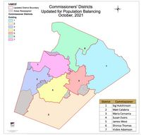 The proposed districts keep each of the commissioners in the same one. Grey areas show where residents may move to a new district.