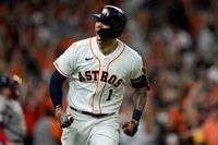 Houston Astros' Carlos Correa celebrates a home run against the Boston Red Sox during the seventh inning in Game 1 of the American League Championship Series on Friday in Houston.