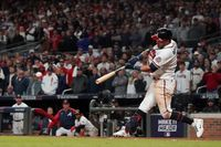Atlanta Braves' Eddie Rosario hits a game winning RBI single during the ninth inning against the Los Angeles Dodgers in Game 2 of baseball's National League Championship Series on Sunday in Atlanta. The Braves defeated the Dodgers 5-4 to lead the series 2-0 games.