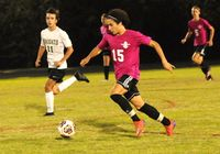 Franklinton's Ryan Martinez dribbles the ball down the field against Northern Nash's defense.