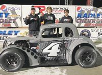 Rocky Mount Academy sophomore Parker Eatmon, center, celebrates his U.S. Legends Racing Young Lion national championship with spotter Jordan Black and crew chief Corey Gordan at Dominion Raceway in Virginia.
