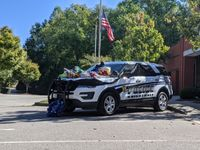 Residents placed flowers and cards in remembrance of Officer Ryan Hayworth on a patrol vehicle outside the Knightdale Public Safety building on Monday.