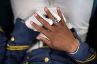 A Citadel cadet puts on his class ring for the first time during the ring presentation ceremony on Oct. 1.