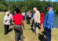 Rep. David Price, center, meets with Wake Forest officials during a tour of infrastructure in September.