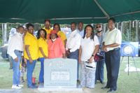 Members of the Wendell-Wake County Branch of NAACP pose with their charter president's gravestone after it was dedicated on Friday.
