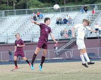 Wakefield's Dryden Vice, left, clears the ball away with his head against Heritage.