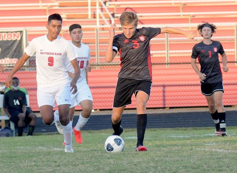 Franklinton's Charlie Lilienthal gets the ball away from Southern Nash defender Frank Gonzalez in a Sept. 27 game at Franklinton. The Firebirds won 4-1, snapping the Red Rams' 12-game winning streak.