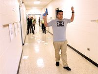 Wilson County sheriff's deputies confront mock gunman Juan Rodgriquez, a sheriff's office detective, during an active shooter drill Wednesday at Stantonsburg Elementary School.