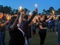 People from across the county attended the candlelight vigil at Knightdale Station Park on Oct. 20 for Officer Ryan Hayworth.