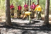 Edgecombe County ranger Adam Green and Wilson County ranger Brandon Webb, both of the N.C. Forest Service, help five  Wilson Community College Fire & Rescue Academy cadets determine a fire's origin.