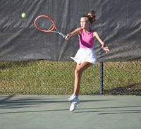 Fike's Caroline Adkins strikes the ball during Thursday's state 3-A dual-team playoff match against Orange. Adkins won both her singles and doubles matchups.