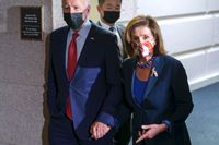 President Joe Biden and Speaker of the House Nancy Pelosi, D-Calif., talk in a basement hallway of the Capitol after meeting with House Democrats to rescue his his $3.5 trillion government overhaul and salvage a related public works bill on Friday.