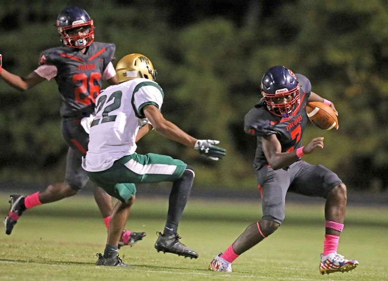 Southern Nash's Tralon Mitchell (7) looks to cut past a defender while Jackson Vick (26) looks on during Friday night's 29-28 overtime loss to Northern Nash.