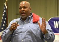 Lt. Gov. Mark Robinson addresses more than 300 guests attending the Wilson County Republican Party's oyster roast fundraiser Saturday night at Scott Farms near Lucama.