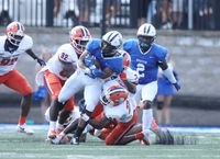 It takes a crowd of Carson-Newman defenders to bring down Barton running back Jordan Terrell (1) on this carry during Saturday's game at Truist Stadium.