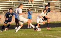 Wakefield's Noah Chaney, left, passes the ball to Wesslen Liddle, right, as he makes a run.