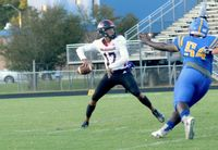 Rolesville quarterback Byrum Brown threw for 204 yards, ran for 154 yards and scored four total touchdowns at Wakefield.