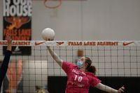 Morgan Newton taps the ball over the net in Franklin Academy's Sept. 30 match against Falls Lake. The Lady Firebirds wore pink for Breast Cancer Awareness Month.