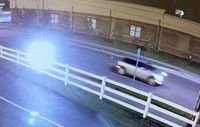 Police say the silver car shown in this surveillance image was seen outside the Christian Faith Center warehouse in Creedmoor two days before a Sept. 26 break-in. The car could be a four-door Mini Cooper or a similar model vehicle.