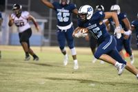 South Granville's Micah Morton rushes for a pick-six during Friday's contest against Southern Durham.