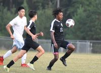 Kanye Owens, far right, was a spark for Granville Central in the first half against county rival South Granville on Monday.