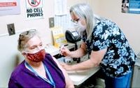 A nurse at the Nash County Health Department administers a coronavirus vaccine in this file photo. Booster shots are now being offered.