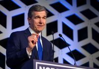 Gov. Roy Cooper speaks at the Blue NC celebration at the Hilton Charlotte University Place in this file photo from Feb. 29, 2020.