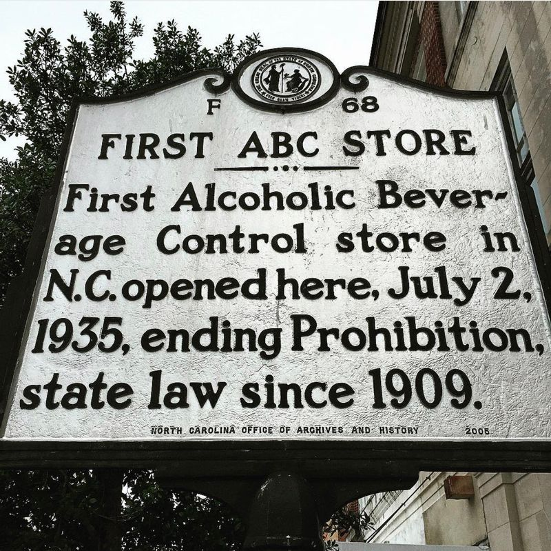A state historical marker in downtown Wilson notes the site of North Carolina's first Alcoholic Beverage Control liquor store.