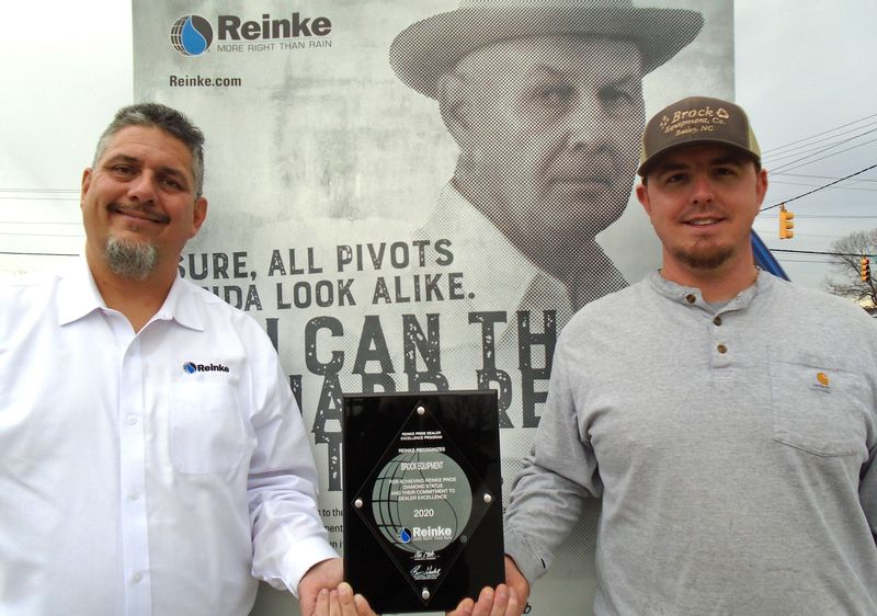 Mike Mills and Tyler Brock are pictured with a Diamond Pride Award from Reinke Manufacturing, a Nebraska-based irrigation systems company. Brock Equipment in Bailey and Calypso was recently honored as a top five Reinke dealership.