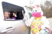 The Easter Bunny delivers a bag of goodies Saturday at Creedmoor's event at Lake Rogers Park.