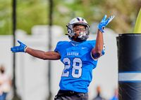 Barton defensive back Mike Webb celebrates after scoring a touchdown on a 27-yard interception return during the second half of Sunday's exhibition game at Truist Stadium. The Bulldogs won 24-7.