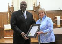 During Sunday's worship service, Mayor Carlton L. Stevens Jr. presented a resolution and proclamation to the congregation of First Christian Church on behalf of the Wilson City Council declaring Tuesday as First Christian Church Day and noting the council's tribute and best wishes on the  church's 150th anniversary. Accepting the framed resolution and proclamation on behalf of First Christian Church is board chair Kathy Daughety. First Christian Church's sesquicentennial celebration begins Tuesday and will continue for 150 days, culminating in a sesquicentennial celebration weekend Sept. 24-26. To learn more about the celebration, visit www.fccwilson.org/150.