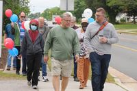 Prayer Walk participants took the opportunity to fellowship during the walk along South Main Street in Wake Forest on May 6, National Day of Prayer.