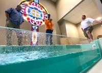 Contractors Aaron Phillips, left, Stacy Bagwell, center, and Jeremy Barnes inspect the new baptistery at Wildwood Free Will Baptist Church on Friday.