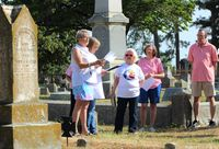Jeannette Etheridge, from left, and Kathy Daughety narrate Saturday's tour of church founders' graves at Maplewood Cemetery.
