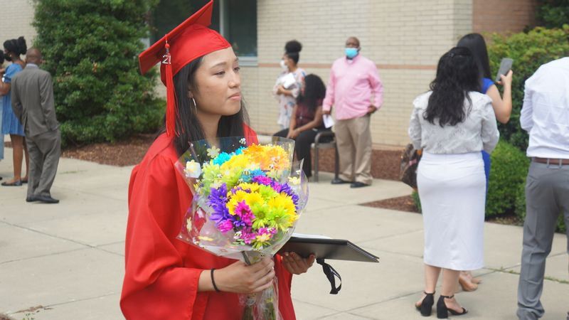 Rolesville High School graduates celebrate with family and classmates.