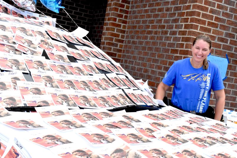 Deputy Elizabeth Cahoon of the Nash County Sheriff's Office smiles during a recent Cover the Cruiser fundraiser. The Sheriff's Office raises money for the Special Olympics North Carolina through such events. Cover the Cruiser, Dunk-a-Deputy and more is set for the 49th annual Spring Hope National Pumpkin Festival on Oct. 2.