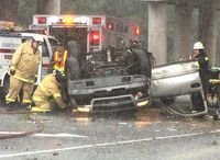 First responders work at the scene of a fatal U.S. 301 wreck at Wilson's Interstate 795 overpass Sunday afternoon.